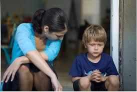 teacher helping child